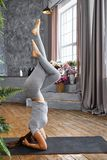 Woman practicing advanced yoga in the living room at home. A series of yoga poses.  royalty free stock images