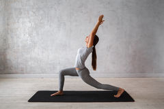 Woman practicing advanced yoga. A series of yoga poses Stock Images