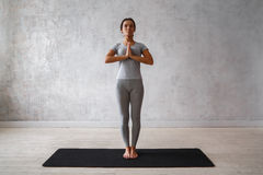 Woman practicing advanced yoga. A series of yoga poses.  royalty free stock image