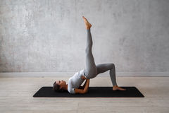 Woman practicing advanced yoga. A series of yoga poses.  Royalty Free Stock Photos