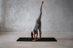 Woman practicing advanced yoga. A series of yoga poses Royalty Free Stock Images