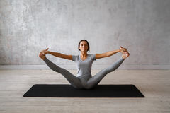Woman practicing advanced yoga. A series of yoga poses Stock Image