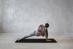 Woman practicing advanced yoga. A series of yoga poses.  royalty free stock photo