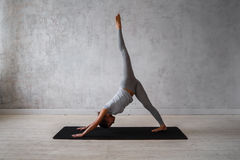 Woman practicing advanced yoga. A series of yoga poses.  royalty free stock photography