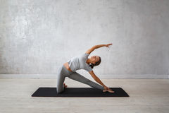 Woman practicing advanced yoga. A series of yoga poses.  stock images