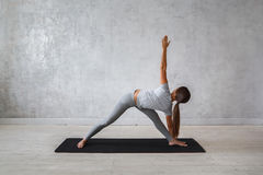 Woman practicing advanced yoga. A series of yoga poses.  royalty free stock images