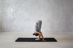 Woman practicing advanced yoga. A series of yoga poses Stock Photography