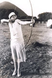 Woman practicing archery Stock Photography