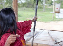 Woman practicing archery Stock Image