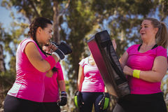Woman practicing boxing in the boot camp Royalty Free Stock Photos