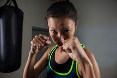 Woman practicing boxing in fitness studio royalty free stock images