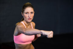Woman practicing boxing in fitness studio Stock Images
