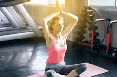 Woman practicing doing yoga exercise workout after in gym,Healthy and lifestyle concept. Women practicing doing yoga exercise workout after in gym,Healthy and stock photos