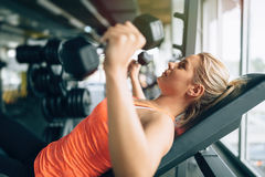 Woman practicing with dumbells Stock Image