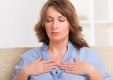 Woman practicing energy medicine stock image