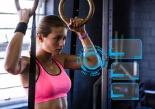 Woman practicing gymnastic exercise against digital interface in background Royalty Free Stock Photos