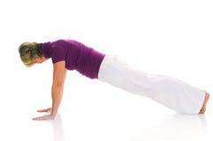 Woman practicing gymnastics Stock Photography