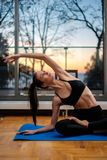 Woman practicing home yoga at home stock photography