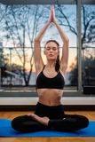 Woman practicing home yoga at home stock image