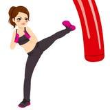 Woman Practicing Kickboxing Royalty Free Stock Photos