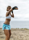 Woman practicing kickboxing Stock Photography