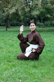 Woman practicing kung fu Stock Photography