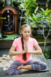 Woman practicing meditation agains tropical forest Stock Photography