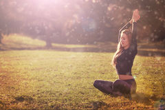 Woman practicing morning meditation in nature Stock Images