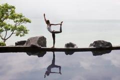Woman practicing morning meditation Yoga at the beach. Woman practicing or doing morning meditation Yoga in nature at the beach Royalty Free Stock Photography