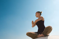 Woman practicing padmasana Stock Images