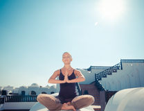 Woman practicing padmasana Stock Photo