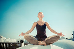 Woman practicing padmasana Stock Image