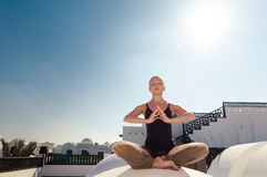 Woman practicing padmasana Stock Photography