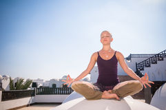 Woman practicing padmasana Royalty Free Stock Image