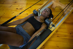 Woman practicing pilates on reformer Stock Photo