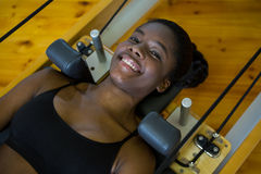 Woman practicing pilates on reformer Royalty Free Stock Photos