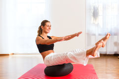 Woman practicing poses on exercise ball Stock Photos