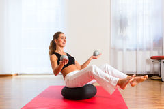 Woman practicing poses on exercise ball Royalty Free Stock Image