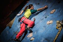 Woman practicing rock-climbing Stock Photo