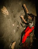 Woman practicing rock-climbing Royalty Free Stock Images