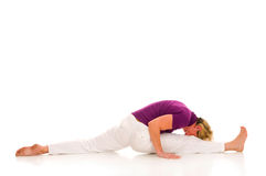 Woman practicing stretching Stock Photography
