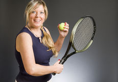 Woman practicing tennis stroke Royalty Free Stock Images