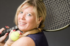 Woman practicing tennis stroke Royalty Free Stock Photos