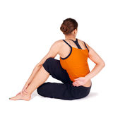 Woman Practicing Twist Pose Yoga Exercise Stock Photo