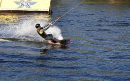 Woman practicing wakeboarding on the lake royalty free stock photography