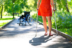 Woman practicing walking on crutches Royalty Free Stock Images