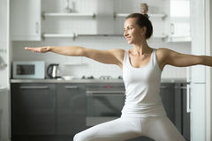 Woman practicing Warrior 2 Stock Image