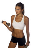 Woman practicing with weights. Young fitness woman practicing with two weights Royalty Free Stock Image