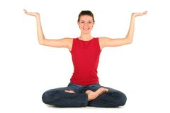 Woman practicing yoga. Woman sitting in lotus position Stock Photo