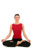 Woman practicing yoga. Woman sitting in lotus position Royalty Free Stock Photography